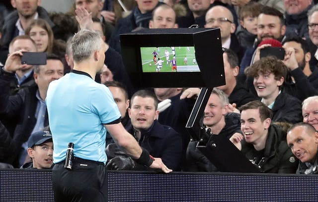 Referee Bjorn Kuipers checks with VAR before awarding Manchester City a penalty against Spurs
