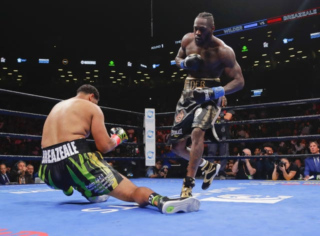 Deontay Wilder knocks out Dominic Breazeale in the first round of their WBC heavyweight title fight in Brooklyn
