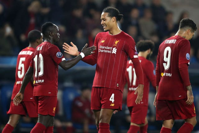 Sadio Mane and Virgil Van Dijk celebrate in Genk