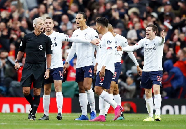 Liverpool players complain to referee Martin Atkinson about United's opener
