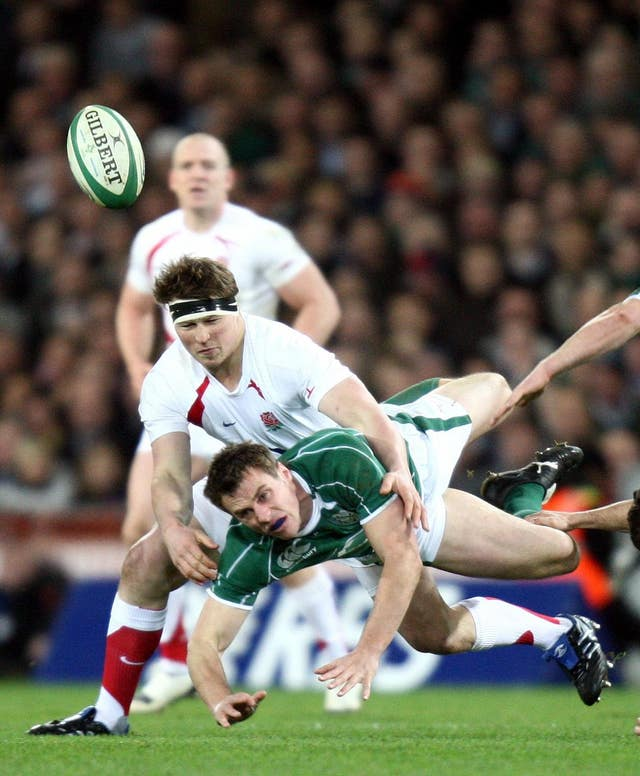 Hartley tackling Ireland's Tommy Bowe during a 2009 Six Nations match at Croke Park