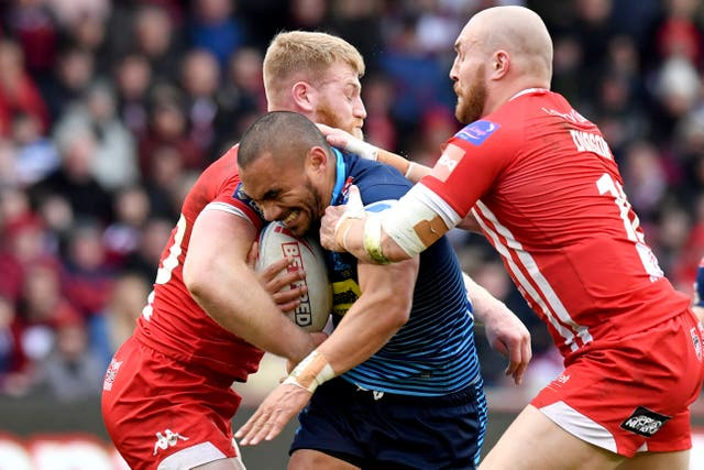 Thomas Leuluai is tackled by Salford's Daniel Murray and Gil Dudson during Wigan's Super League win on Sunday