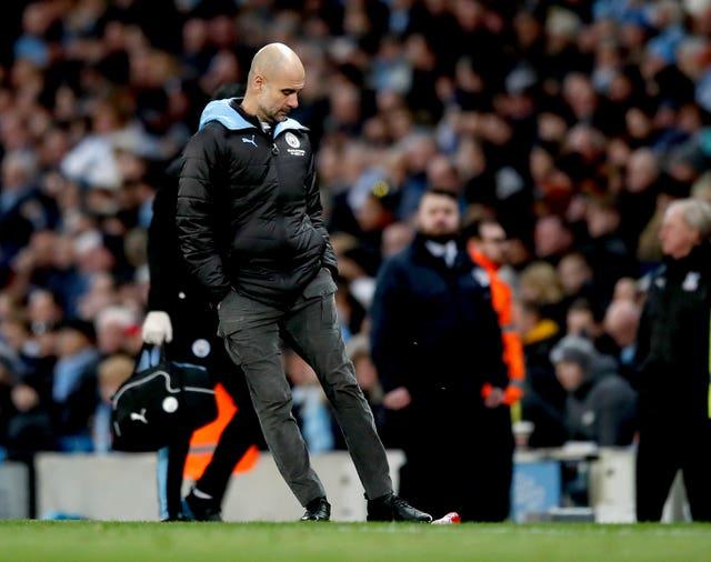 Manchester City manager Pep Guardiola kicks a bottle in frustration after Fernandinho scores an own goal