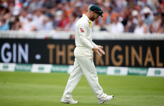 David Warner shows a baying Hollies Stand crowd his hands after being heckled for 'sandpapergate' while fielding on the boundary (Nick Potts/PA)