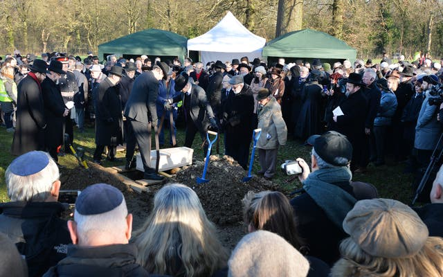 The coffin is buried at the United Synagogue's New Cemetery