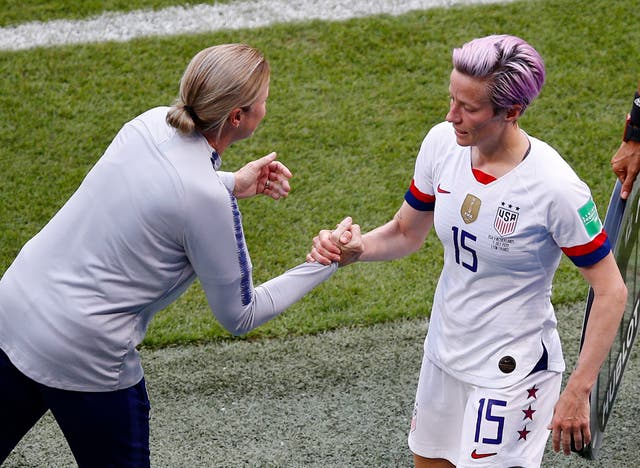 United States coach Jill Ellis shakes hands with Megan Rapinoe