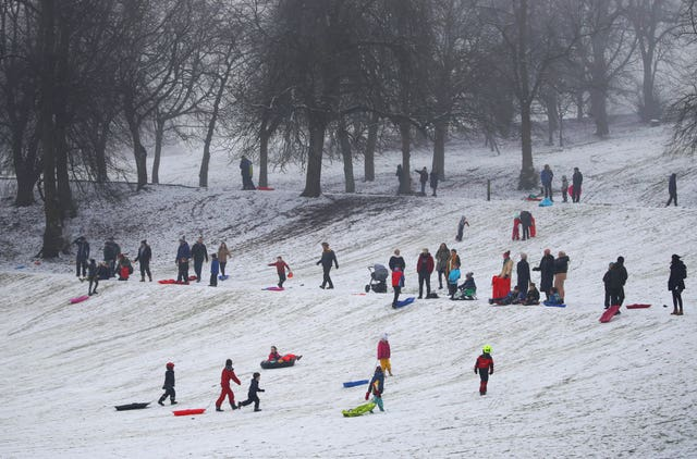 People sledging in Queen's Park in Glasgow