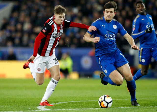 David Brooks, left, in action for Sheffield United against Leicester's Harry Maguire