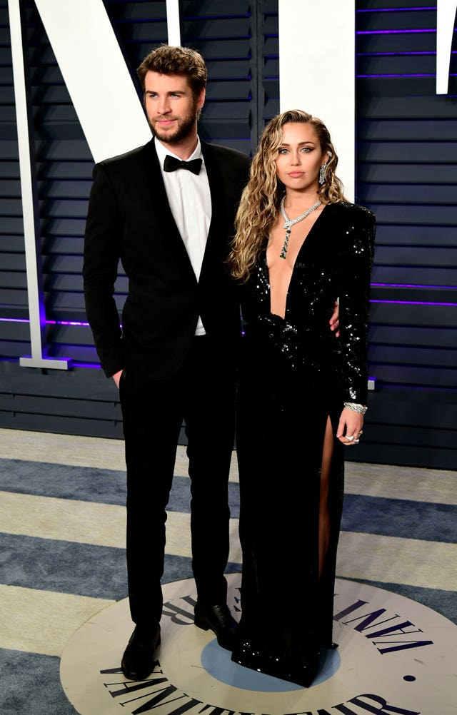 Liam Hemsworth (left) and Miley Cyrus