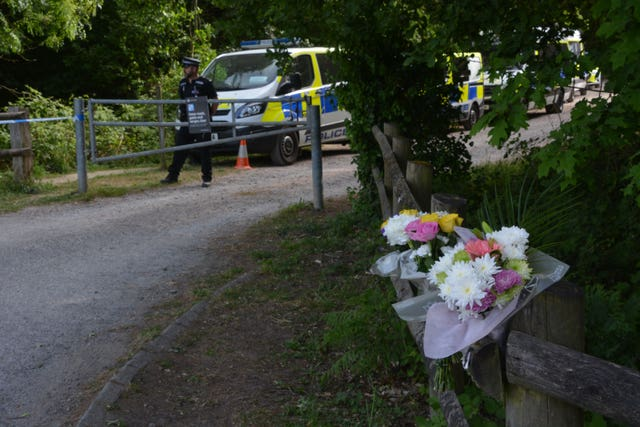 Flowers left outside Havant Thicket in Hampshire, where the body of 16-year-old Louise Smith was found