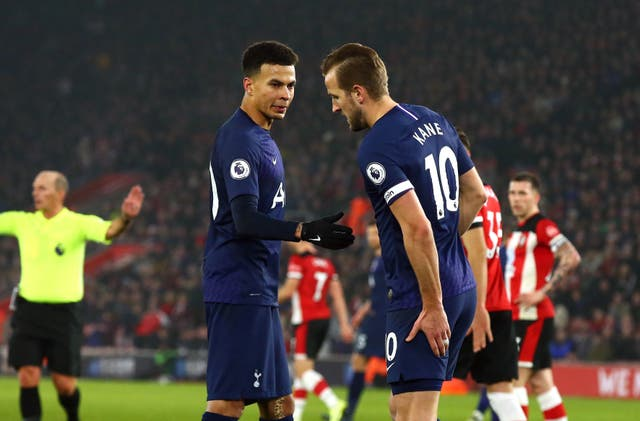 Harry Kane, right, holds his hamstring after suffering an injury in a match against Southampton