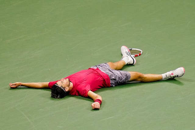 Dominic Thiem lies exhausted and elated on the court