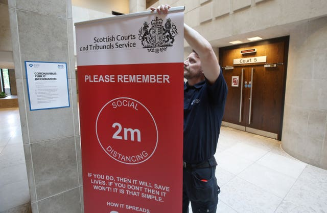 Social distance signage outside Courtroom Five at Glasgow Sheriff Court