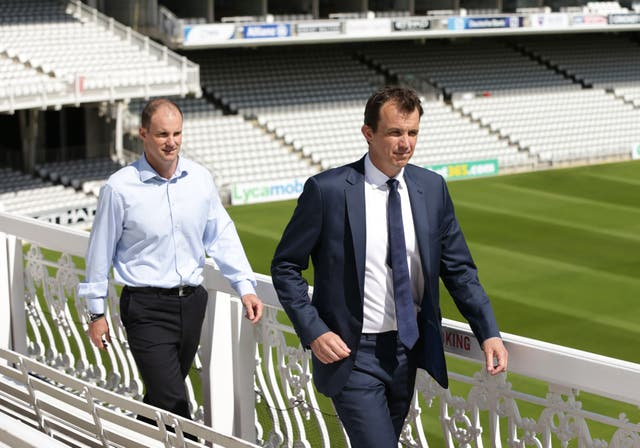ECB chief executive Tom Harrison, right, says there will be no professional cricket played until it is safe to do so