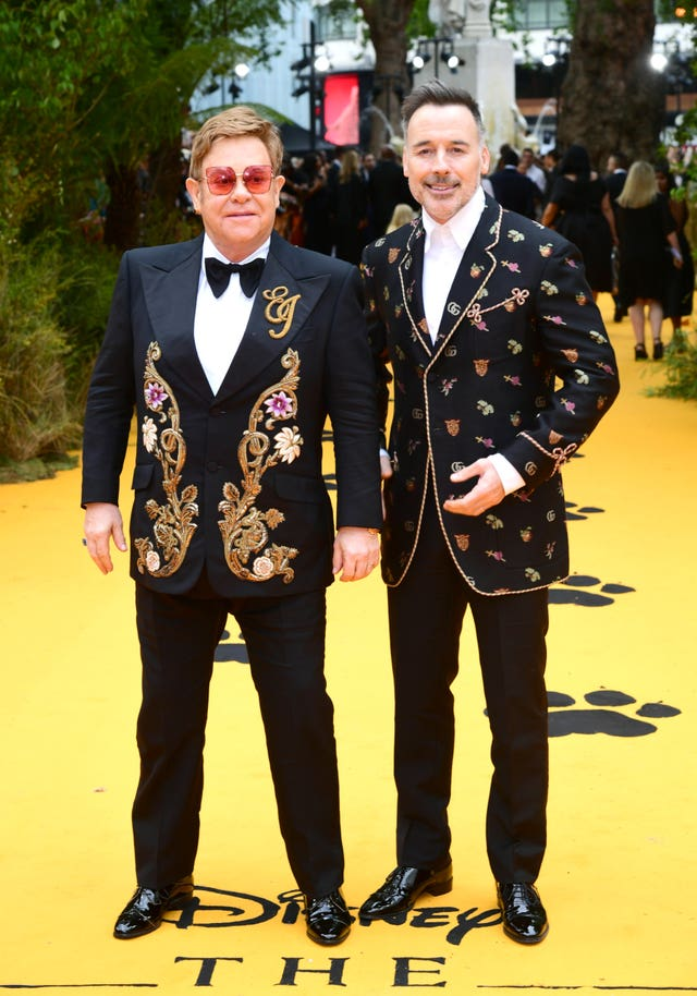 Sir Elton John and David Furnish attending The Lion King European premiere