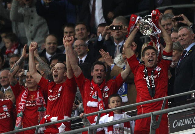 Liverpool's captain Steven Gerrard lifts the Carling Cup, the first trophy under American ownership
