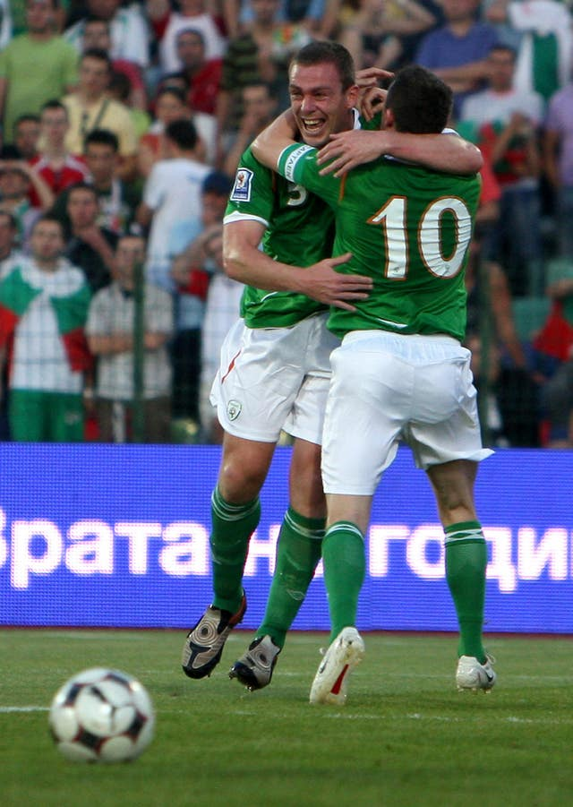 Republic of Ireland defender Richard Dunne is congratulated by Robbie Keane after scoring in Sofia