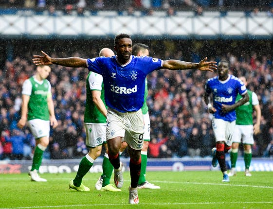 Jermain Defoe scored a hat-trick as Rangers eased to a 6-1 triumph over 10-man Hibernian