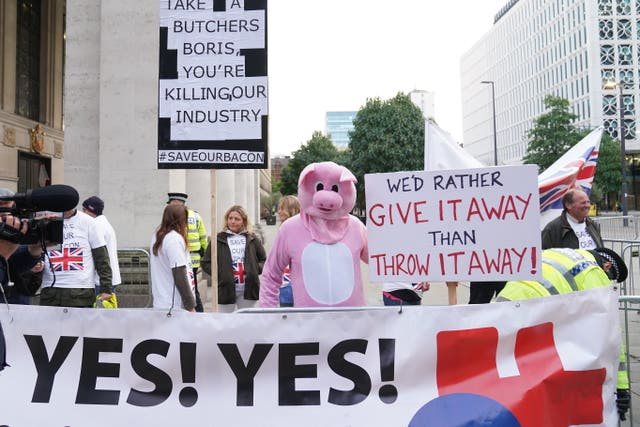 Pig farmers protesting outside the Conservative Party Conference in Manchester