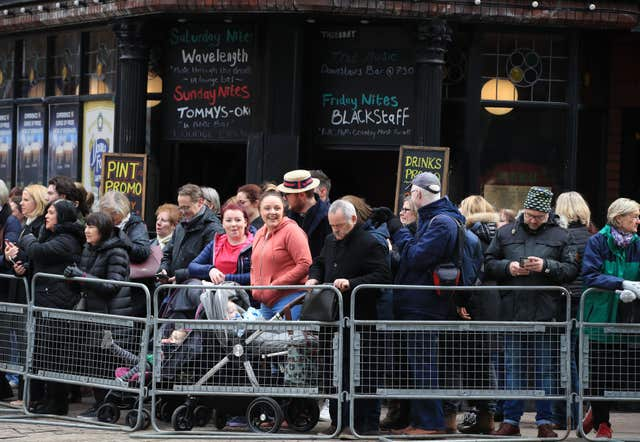 Crowds waiting for the royal couple to arrive for a walkabout in Belfast City centre (Peter Byrne/PA)