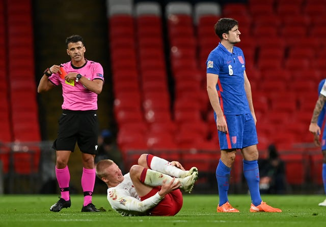 Harry Maguire, right, reacts after being sent off