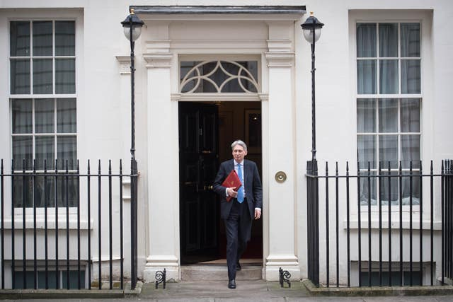 Chancellor of the Exchequer Philip Hammond heads to the House of Commons to deliver his first spring statement. (Stefan Rousseau/PA)