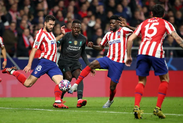 Liverpool's Divock Origi is outnumbered in Madrid