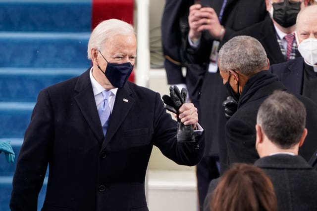 Joe Biden is greeted by former president Barack Obama