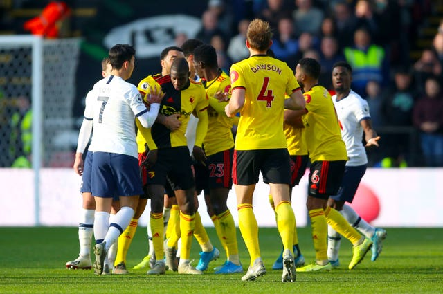 Watford's Abdoulaye Doucoure and Tottenham players in an altercation at Vicarage Road