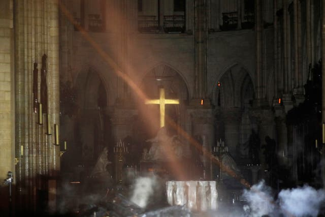 Smoke is seen around the alter inside Notre Dame