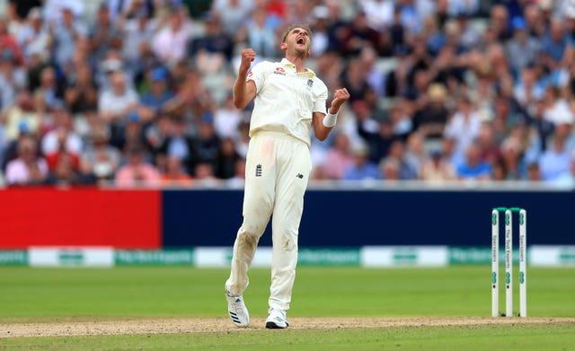 Stuart Broad celebrates taking the wicket of Australia's Steve Smith