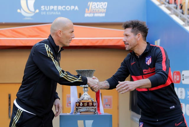 Zinedine Zidane shakes hands with Diego Simeone ahead of Sunday's final