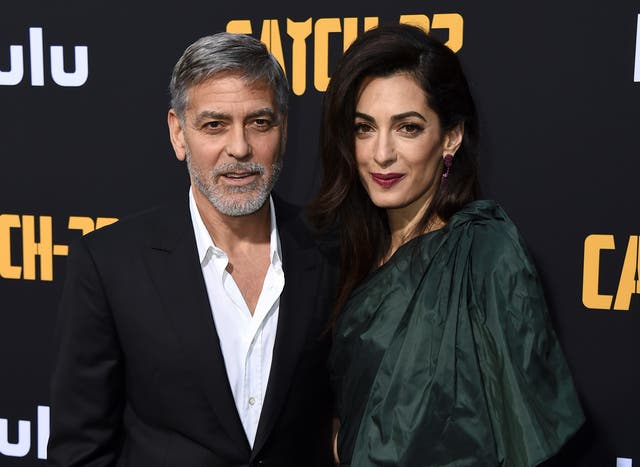 George and Amal Clooney arrive at the Los Angeles premiere of Catch-22 at TCL Chinese Theatre