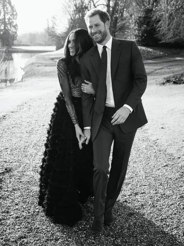 Meghan in a Ralph & Russo gown, with Harry (Alexi Lubomirski/PA)