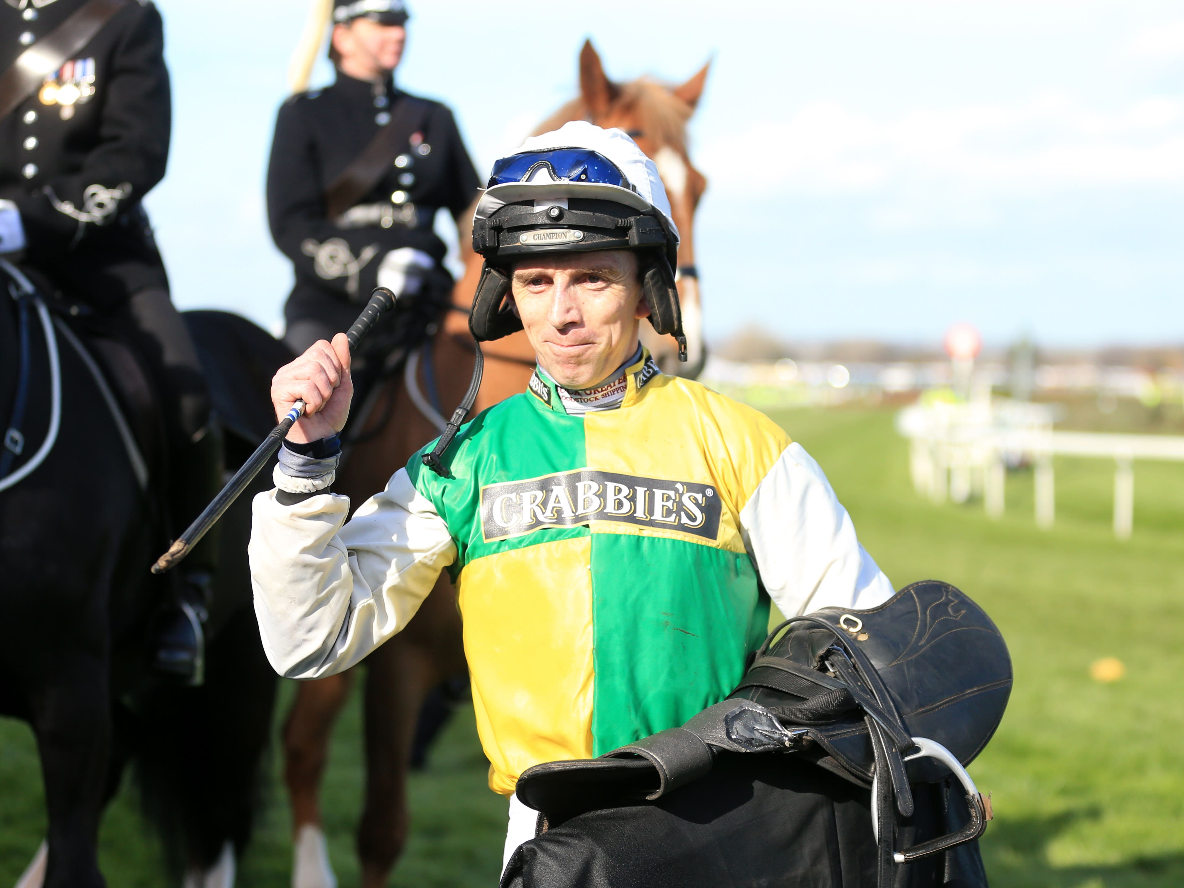 Leighton Aspell celebrates after victory in the Grand National on Many Clouds (Mike Egerton/PA)