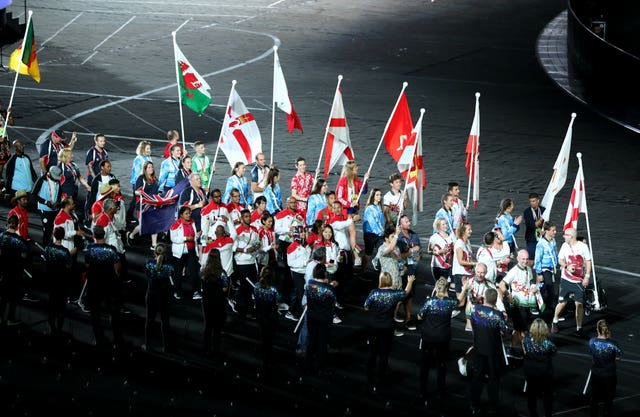 Athletes enter the stadium bearing flags (Danny Lawson/PA)