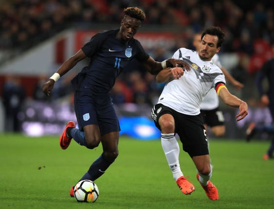 Abraham (left) made his senior England debut against Germany in November 2017 (Mike Egerton/PA).