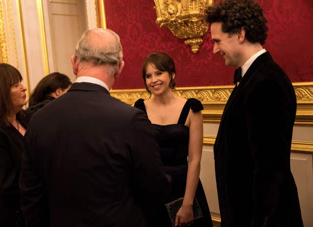 Charles meets actress Felicity Jones (John Phillips/PA)