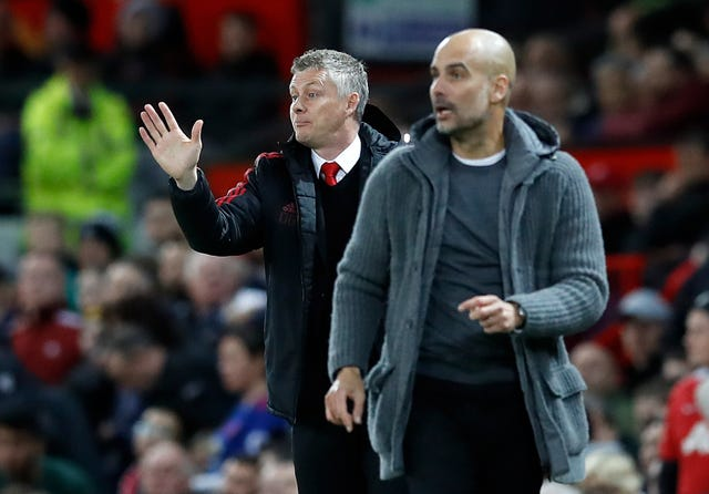 Manchester United manager Ole Gunnar Solskjaer (left)suggested Guardiola's side commit tactical fouls ahead of last season's derby