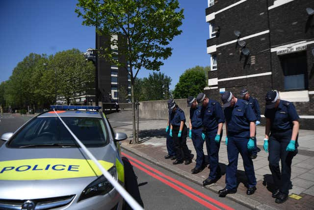 Police comb a cordoned area in south London after the shooting of 17-year-old Rhyhiem Ainsworth Barton (Victoria Jones/PA)