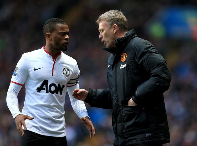 David Moyes, right, worked alongside Patrice Evra at Manchester United