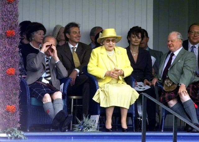Tony Blair and the Queen watch the games at the Braemar Gathering in 1999