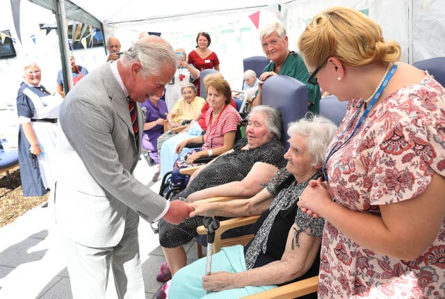 Charles meets patients sat the hospital