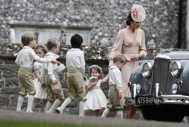 The Duchess of Cambridge with Prince George and Princess Charlotte at Pippa Middleton's wedding to James Matthews (Kirsty Wigglesworth/PA)