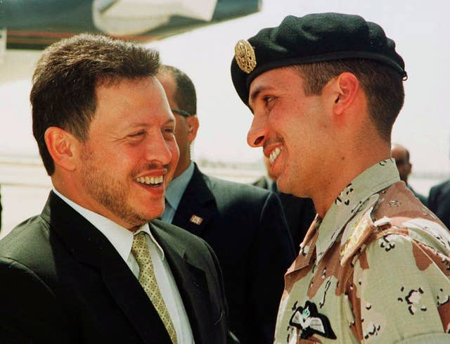King Abdullah II laughs with his half brother Prince Hamzah, right, in a picture taken in 2001 (Yousef Allan/AP)