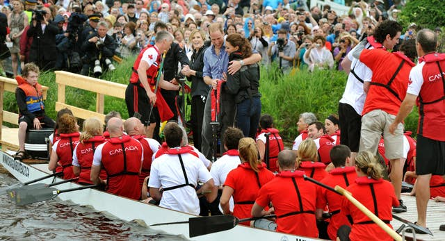 The Duchess of Cambridge is hugged by the Duke of Cambridge after a boat race across a lake on Prince Edward Island, eastern Canada