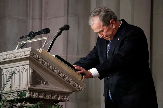 George W Bush pauses as he delivers his eulogy