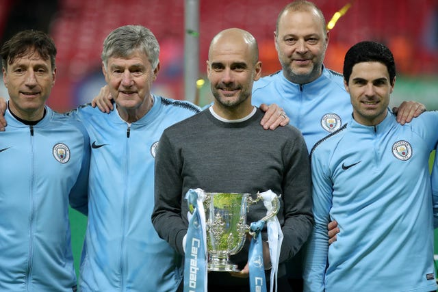 Pep Guardiola and his backroom staff celebrate with the Carabao Cup last season