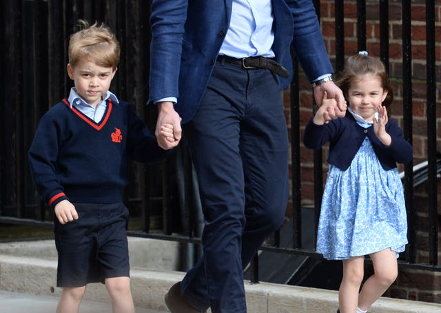 The Duke of Cambridge with Prince George and Princess Charlotte arriving at the Lindo Wing to meet Prince Louis (Kirsty O'Connor/PA)