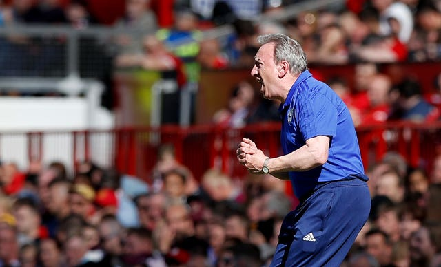 Neil Warnock ended his Premier League tenure with a win at Old Trafford